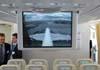 Telão a frente dos assentos da Classe Econômica do Airbus A380, número de série 007, F-WWJB, futuro avião da Emirates. Repare no inseto aparecendo no lado esquerdo do telão. (11/12/2007)