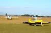 Aeronaves estacionadas no Aeroporto de Casa Branca. Atrás, pela esquerda, o Beechcraft V-35B Bonanza, PT-ISP, ao lado do Beechcraft F-33A Bonanza, PT-WFF, e, à frente, o Vans RV-7, PP-XTX, do Comandante Beto Textor. (19/07/2008)