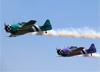 Passagem dos North American T-6Dde prefixo  PT-KRC e PT-LDQ do Circo Aéreo. (02/08/2014)