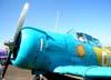 O nosso colaborador, Comandante João Thiago Domingues, no cockpit do North American T-6D, PT-KRC, aeronave número 1 da Esquadrilha OI. Será que deu vontade de acionar o enorme motor radial Pratt & Whitney R-1340-AN1 Wasp, de 9 cilindros, com 600 hp de potência, e sair voando? Foto: João Thiago Domingues.