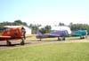 Aviões da Esquadrilha OI: Da esquerda para a direita, o North American T-6D, PT-LDO, aeronave número 3, North American T-6D, PT-LDQ, aeronave número 2, e o North American T-6D, PT-KRC, aeronave número 1. Foto: João Thiago Domingues.