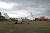 Aeronaves estacionadas no pátio em frente ao hangar da TAM. Em primeiro plano, o Embraer EMB-110C Bandeirante, PT-EDO, da Extreme Táxi Aéreo. No fundo vê-se o Airbus A330-223, PT-MVD, da TAM. (08/12/2007)