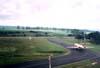 """Fokker 100 da TAM taxiando em direção ao Centro Tecnológico da companhia paulista. Repare que há um carro em frente ao avião - seria o """"Follow-me""""? (04/2003) Foto: Rogério Castellao."""
