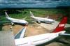 Três Airbus A330-200 da TAM. Em primeiro plano, o PT-MVE, que foi recebido pela TAM diretamente do fabricante no dia 10 de novembro de 2000, operou na Etihad (companhia dos Emirados Árabes Unidos, com sede em Abu Dhabi) entre 1° de novembro de 2003 e 19 de outubro de 2006 (por wet lease), quando retornou à TAM e, logo atrás, o PT-MVA (direita) e o PT-MVB logo depois de voltarem da China Airlines (de Taiwan), que pintou os dois aviões, mas não chegou a operá-los devido à gripe aviária (SARS) e os devolveu à TAM, que os alugou (wet lease) para a South African e para a Etihad até 2006 (PT-MVA) e 2005 (PT-MVB), quando retornaram à companhia paulista, que os recebeu diretamente do fabricante em 23 de novembro de 1998. (04/2003) Foto: Rogério Castellao.