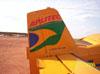 Cauda do Neiva EMB-201A Ipanema (PT-GYT), estacionado no pátio da aviação geral.