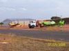 Em primeiro plano, um Neiva EMB 201AR Ipanema (verde), e em segundo plano um Neiva Ipanema 201A, estacionados ao lado do pátio da aviação geral.