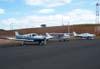 Da esquerda para a direita, Piper Saratoga II TC, N9288X, Cessna 150J, PT-AKY, da Mariano Escola de Aviação e Piper/Embraer EMB-712 Tupi, PT-NXW, também da Mariano Escola de Aviação. (12/05/2007)