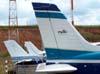 A primeira cauda é do Piper Saratoga II TC, N9288X, logo atrás está a cauda do Cessna 150J, PT-AKY, da Mariano Escola de Aviação e, por último, a cauda do Piper/Embraer EMB-712 Tupi, PT-NXW, também da Mariano Escola de Aviação. (30/04/2007)