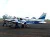 Piper/Neiva EMB-712 Tupi, PT-VFH, do Aeroclube de Batatais, sendo empurrado para o hangar durante a chuva.