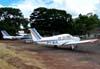 Em primeiro plano, o Piper/Neiva EMB-711C Corisco, PT-NJL, e atrás dele, o Cessna 172E, PT-CDO, com a pintura da Air France na cauda, aeronave utilizada na gravação do último capítulo da novela Roque Santeiro, da Rede Globo, em 1986.