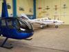 Robinson R44 em primeiro plano e um Seneca logo atrás.