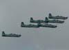 Tucanos 7, 4, 3, 6, 2, 7, da esquerda para a direita, da Esquadrilha da Fumaça treinando sobre a cidade de São Carlos. (15/12/06)