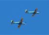 Dois Embraer EMB-314 Super Tucano (A-29A), da Esquadrilha da Fumaça (EDA - Esquadrão de Demonstração Aérea) da FAB (Força Aérea Brasileira), sobrevoando São Carlos (SP). (31/01/2018)