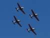 Quatro Neiva T-25 Universal voando em formação diamente.