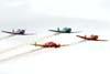 Aeronaves da Esquadrilha Oi fazendo uma passagem em formação diamante.