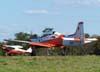 Embraer T-27 Tucano, FAB 1382, da Academia da Força Aérea, e em segundo plano, o Aero Boero 115, PP-GLA, do Aeroclube de Bragança Paulista.