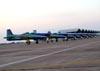 Tucanos da Esquadrilha da Fumaça taxiando no pátio da Academia da Força Aérea após a apresentação.