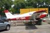 Piper PA-28-140 Cherokee, PT-DHC, do Aeroclube de São Paulo, de frente para a avenida Olavo Fontoura, no Campo de Marte. (14/10/2006)
