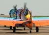 Aviões da Esquadrilha OI: North American T-6D, PT-KRC, aeronave número 1 (verde), pilotada pelo Carlos Edo, North American T-6D, PT-LDQ (roxa), aeronave número 2, comandada pelo Laert Gouvêa e o North American T-6D, PT-LDO (laranja), aeronave número 3, pilotada pelo Gustavo Albrecht, taxiando em direção à pista 02/20. Foto: Bruno Schmidt