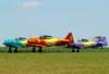 Esquadrilha OI durante a decolagem. A partir da esquerda, o North American T-6D, PT-KRC, aeronave número 1, pilotada pelo Carlos Edo, North American T-6D, PT-LDQ, aeronave número 2, comandada pelo Laert Gouvêa e o North American T-6D, PT-LDO, aeronave número 3, pilotada pelo Gustavo Albrecht.