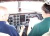 """Os comandantes norte-americanos Doug, a esquerda, e John Papas, realizando a longa check-list do Douglas DC-3 """"Rose"""", N101KC, estacionado ao lado da torre de controle do aeroporto de São Carlos. (30/08/2007)"""