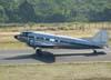 """Douglas DC-3 """"Rose"""", N101KC, fazendo """"back track"""" em direção ao hangar ao lado de torre de controle, logo após o pouso no aeroporto de São Carlos. (31/08/2007)"""