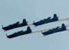Tucanos 1, 2, 3 e 4, da Esquadrilha da Fumaça, saindo de um tunneau. Foto: Rodrigo Zanette