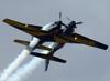 """Os Embraer EMB-312 (T-27 Tucano) da Esquadrilha da Fumaça fazendo a manobra """"Panqueca"""". (23/09/2012)"""