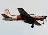 Embraer EMB-312 (T-27 Tucano), FAB 1383, da AFA (Academia da Força Aérea - Brasil), sobrevoando o Campo de Marte, em São Paulo, durante o Domingo Aéreo do PAMA-SP. (28/09/2014)