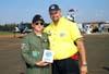 Da esquerda para a direita, Coronel Maximo Ballatore Holland, Comandante da Base Aérea de campo Grande/MS, sendo homenageado por Fernando Pavan, Membro Honorário da Força Aérea Brasileira, em nome do GAFAB, Grupo de Apoio à FAB, organizador do evento. Foto: GAFAB (02/09/2007)