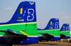 Caudas dos Tucanos 3, FAB 1327; 2, FAB 1307; e 1, FAB 1308, da Esquadrilha da Fumaça, estacionados no pátio. Foto: Luiz Renato Blumlein Vieira (02/09/2007)