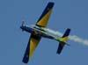 Tucano número 7 da Esquadrilha da Fumaça, comandado pelo Capitão Aviador Gustavo Luís, realizando um tunneau de 4 tempos. (02/09/2007)