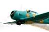 Decolagem do North American T-6D, PT-KRC (verde), aeronave número 1 da Esquadrilha Oi, pilotada pelo Comandante Carlos Edo. Foto: Bruno Schmidt.