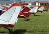 Caudas de aeronaves do Aeroclube de Rio Claro. Em primeiro plano, o Aero Boero 180 PP-GBM, depois o Neiva P-56C Paulistinha PP-HPL, seguido pelo Aero Boero 115 PP-FLF, Aero Boero 180 PP-GNR, e o Piper J-3 PP-RSI.