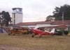 Aviões do Aero-clube de Rio Claro. Em primeiro plano um Aero Boero 180 e depois um Piper J3.