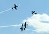 Cruzamento duplo dos Embraer EMB-312 (T-27 Tucano) números 1, 2, 3 e 4 da Esquadrilha da Fumaça. (14/08/2011)