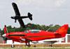 "Saum Nicholas SAUM SX-400, N1NV, e Piper PA-18A Super Cub, N6777B, (Chamado ""Franklinstein""), de Kyle Franklin. (30/03/2012) Foto: Nicole Passerani."