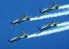 T-27 Tucanos 1, 2, 3 e 4 da Esquadrilha da Fumaça voando em formação diamante. (01/07/2007)