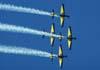 T-27 Tucanos 1, 2, 3 e 4 da Esquadrilha da Fumaça realizando um tunneau em formação diamante. (01/07/2007)