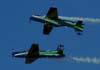 Espelho, manobra feita com os T-27 Tucanos 5 e 6 da Esquadrilha da Fumaça. Repare que foi usado um segundo Tucano com o número 3 no lugar do número 6. (01/07/2007)